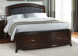 dark brown polished wooden king size beds with storage drawers and black leather headboard brown dark gray