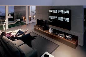contemporary living room dark floor modern living room with dark wood media center interior design ideas
