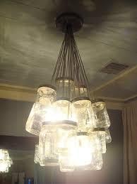 1 diy tutorial for a mason jar chandelier diy vintage mason jar chandelier