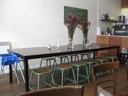 dining room pub style sets: stunning long wooden narrow dining table for space with near green chair on calm parquet plus