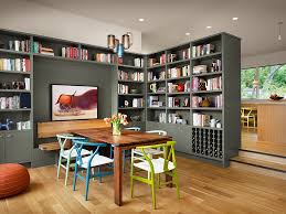 view in gallery colorful collection of wishbone chairs and gorgeous gray bookshelves add to the charm of this dining bookcase book shelf library bookshelf read office