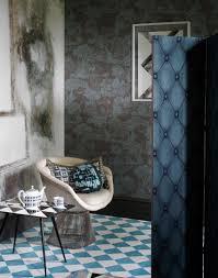 zones bedroom wallpaper: modern graphic living room corner with muted toile wallpaper