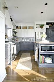 kitchen colors images: white painted upper cabinets seem to float while sophisticated gray blue built