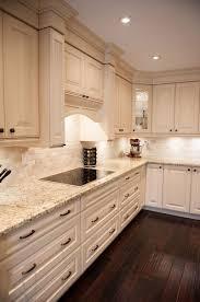 kitchen cabinets with granite countertops: white kitchen design giallo ornamental granite countertops white cabinets dark wood flooring