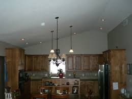 outstanding vaulted ceiling ideas with pendant lighting and wooden kitchen cabinet also black countertops for modern awesome pendant lighting sloped ceiling