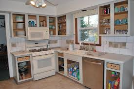 painted kitchen cabinets vintage cream:  interesting kitchen color ideas with white cabinets tv above fireplace