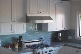 kitchen backsplash stainless steel tiles: subway tile kitchen backsplash ideas with blue porcelain tile also chimney also gas stove also granite