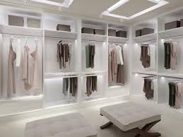 lighting for closets. master closet only with chocolate hardwood floors embedded ceiling lighting and a crystal chandelier for closets