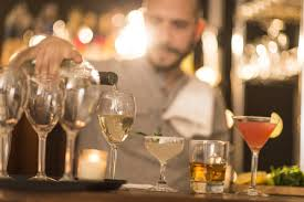 where to seasonal jobs and how to make them last past the bartender pouring drinks at bar