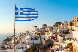 Greek Flag  Oia  Santorini  Greece   Chris Hepburn The Image Bank  Greece Travel   About com