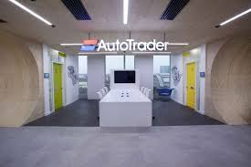 autotrader london office design by claremont group interiors an italian job inspired tunnel complete with three suspended original minis in red autotrader london office 1