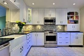 white kitchen cabinets with under cabinet lighting and mosaic tile backsplash for modern kitchen cabinets and cabinet lighting backsplash home design