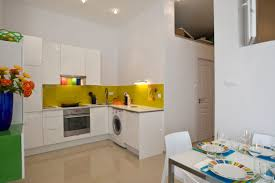white modern kitchen with purple led under cabinet lighting contemporary kitchen with gray cabinets and yellow cabinet lighting backsplash home