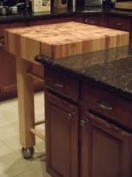 countertops dark wood kitchen islands table: butcher block kitchen island cart custom walnut butcher block dining table