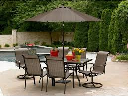 f cool outdoor furniture ideas for edge pool garden the featuring stylish black metal dining table with stand umbrella and six dining chairs placed on black outdoor furniture