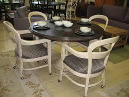 dining table with wheels: dining table with caster chairs and white painted pine combined gray fabric padded seat wheels also round dining table with pedestal as well as black dining