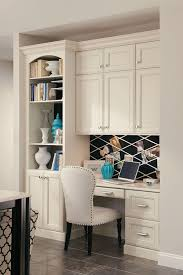kitchen cabinets home office transitional: a built in desk with bookcase and cabinets creates a seamless home office in a