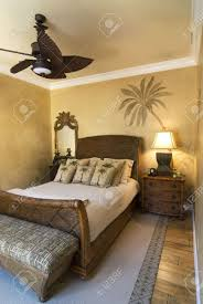 stock photo bedroom decorated in tropical style with ceiling fan caribbean bedroom furniture