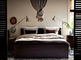 reading lamp for bedroom with bright white light bulbs above brown throw pillows and cream egyptian above bed lighting