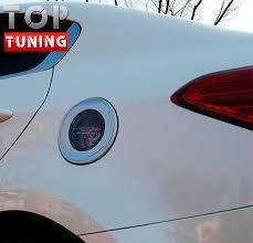 <b>Накладка на лючок бензобака</b> EXOS на Kia Cerato 3