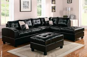elegant family room interior design with black leather sofa with cushions also table black leather sofa