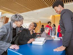 careers in aerospace technology nasa margot lee shetterly warmly greets a colloquium attendee 7 at a post talk book