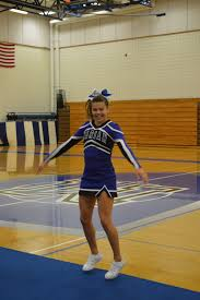 marian girl tries out cheerleading finds new love the network  photo by emmie mcminn emmy witzenburg stretches a smile before her performance on freshmen