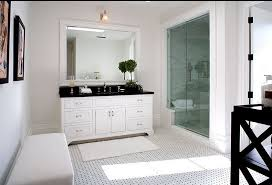 black and white master bathroom in a spanish revival home with glass shower and a white black white home office cococozy 5