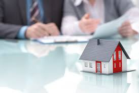 steps to a successful residential bid every construction manager businessman signs contract behind home architectural model