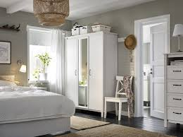a small bedroom furnished with a wardrobe with two white doors and one mirror door bedroom furniture at ikea