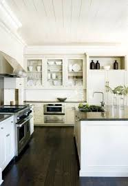 white kitchen dark hardwood floors
