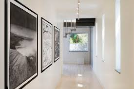 black and white picture frame ideas hall modern with ceiling lighting gallery wall wall art art gallery track lighting