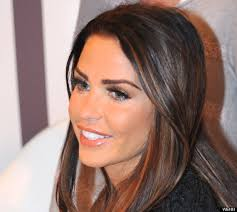 Katie Price. The former glamour model cavorted around on the sand, flipped photographers the bird and accidentally popped out of her short bridal gown. - o-KATIE-PRICE-570