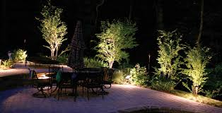 patio lighting extends amount surrounded by soft landscape lighting for a romantic mood effect on th