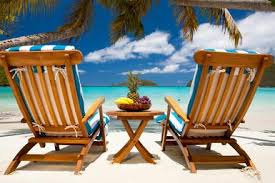 chairs and table with fruit at a tropical caribbean beach christian wheatleye caribbean furniture
