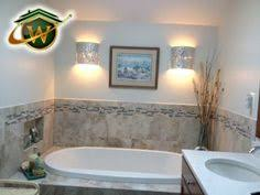 custom built drop in soaking tub installation with wall niche and ambient lighting ambient lighting creates