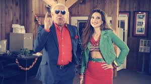 ric flair is a complete lunatic as a used car sman in ads for channeling his real insanity