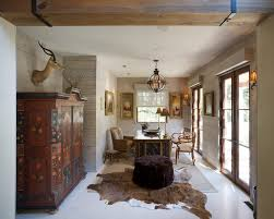 cowhide zebra rug home office traditional with arm chairs wood lintel animal hide rugs home office traditional