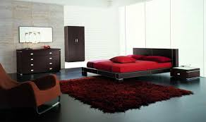 cool red and black interior colors of men bedroom ideas with italian queen bed and nightstand furnished with soft rug and completed with dark brown drawers amazing bedroom awesome black