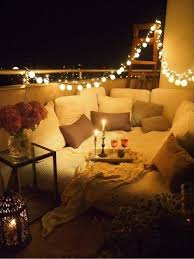 go all out with cushions pillows and string lighting balcony lighting