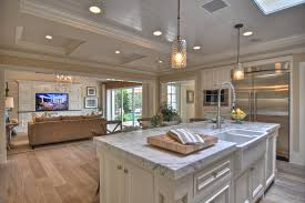white washed oak flooring kitchen traditional with backsplash baseboards beach house beach house kitchen nickel oversized pendant