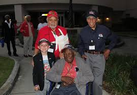the little boy the big heart for the tuskegee airmen red quinn thorne original tuskegee airmen from top left leo gray dr roscoe brown and the late calvin spann