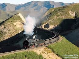 Image result for train in a green hill tunnel with clouds