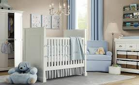 subtle light blue curtains armchair and bedding complement light beige walls and white painted baby boy furniture nursery
