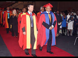 Professors Yusuf Karodia (right) and Mark Hay seen leading the academic procession at MANCOSA's graduation ceremony. THE Management College of Southern ... - 23lbgrad_520984248