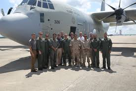 members of the kuwait air force and aviation training consulting pose near the first kuwait air cherry air force 1