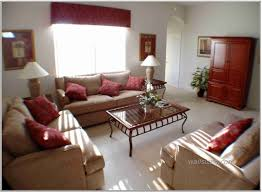 excellent comfortable small family room decorating ideas red pillows sofa furniture square coffee table cherry cabinet chic family room decorating ideas