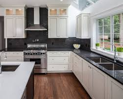 kitchen cabinets with granite countertops: white hanging cabinet finish patterned black granite countertop kitchen backsplash