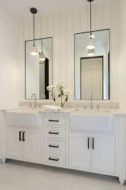 bathroom shiplap wall behind mirrors bathroom with shiplap wall behind mirrors bathroom vanity barnwood mirror oyster pendant lights