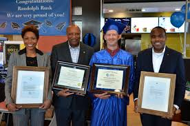 archways to opportunity local crew member receives high school mcdonald s franchisee ashley welburn mcdonald s franchisee craig welburn sr randolph rusk and mcdonald s steven hunter display randolph s diploma and